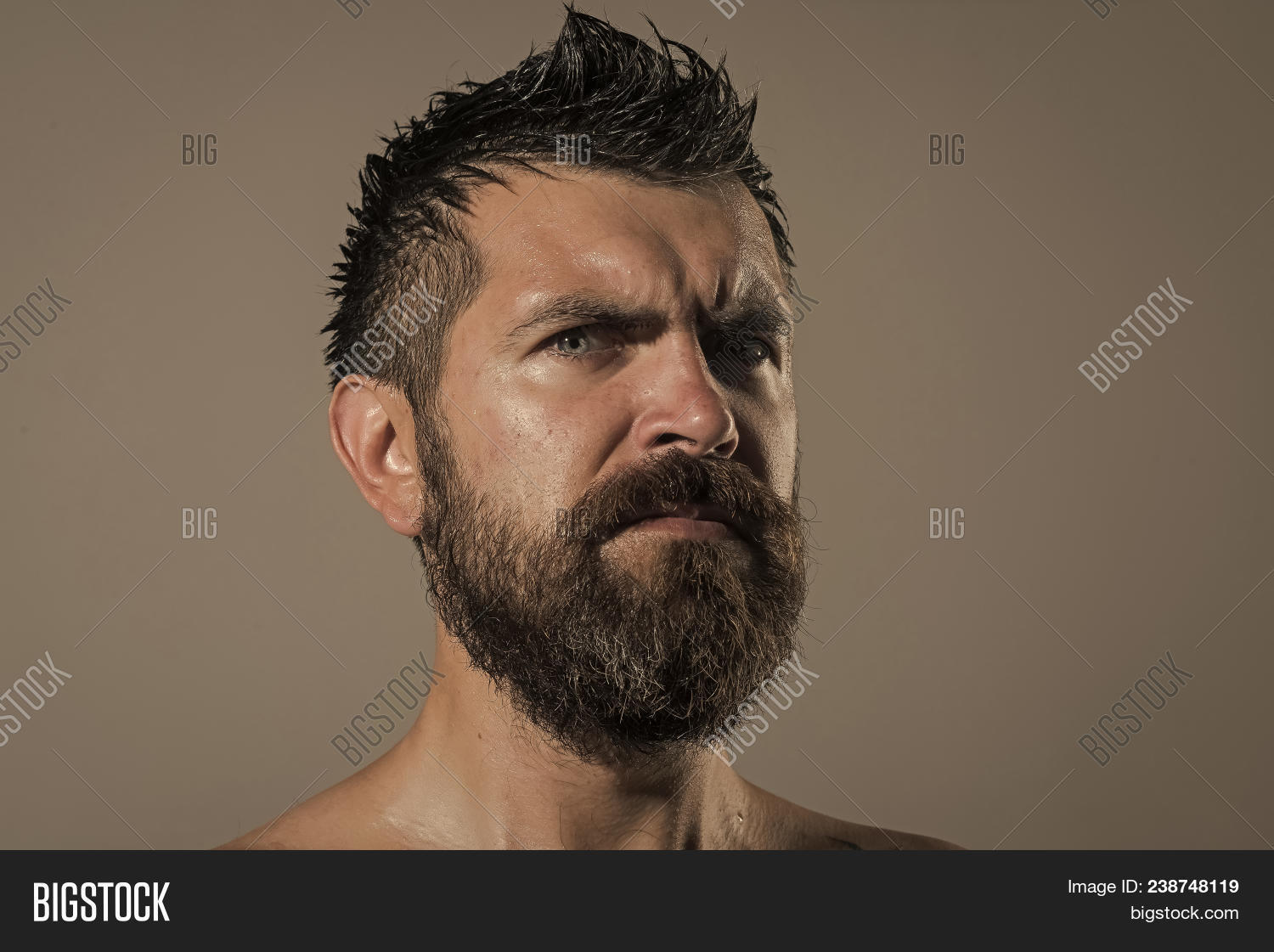 Serious face guy naked